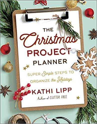 Write down a detailed list in a Christmas planner.
