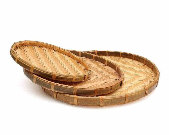 Add bohemian styled trays for added depth - Everything Abode