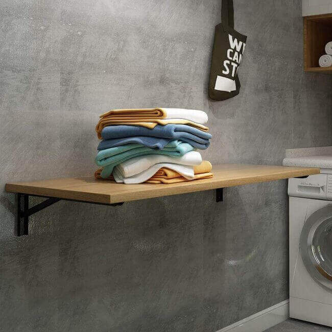 Add this nifty folding station to make folding your clothes (before you leave the laundry room) a breeze. - Everything Abode