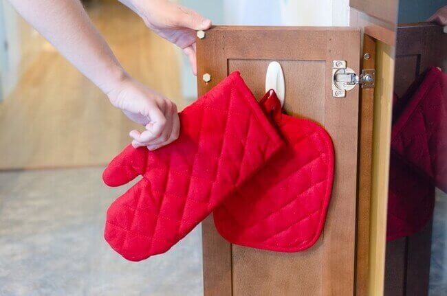 Hang your mitts and most used towels - kitchen organizing made easier - Everything Abode