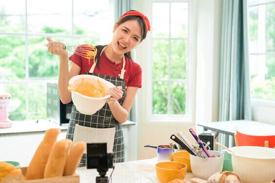 Popular Indoor Hobbies, indoor winter hobbies, indoor hobbies, best indoor hobbies, women holding baking bowl smiling in kitchen