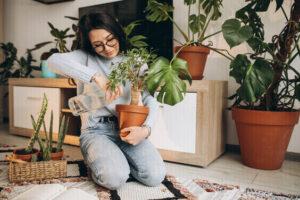 women planting plants in her living room as her fun indoor hobby