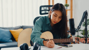 woman creating music for fun winter indoor hobby on her day off