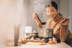 woman cooking in kitchen for fun hobby