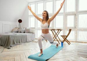 women doing yoga pose on floor in her bedroom for indoor winter hobby
