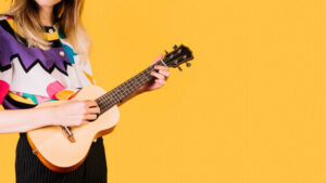 unique indoor hobby girl playing ukulele