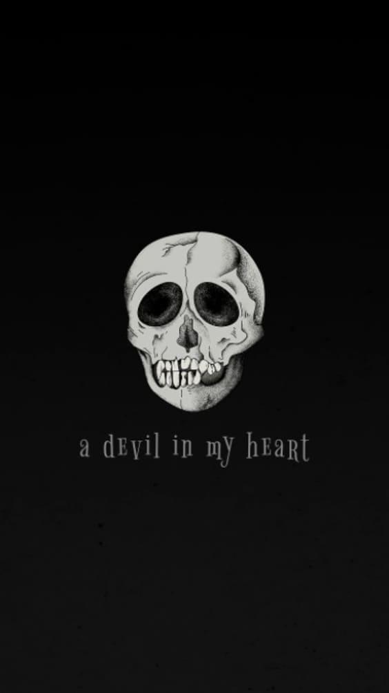 dark skull on black background wallpaper