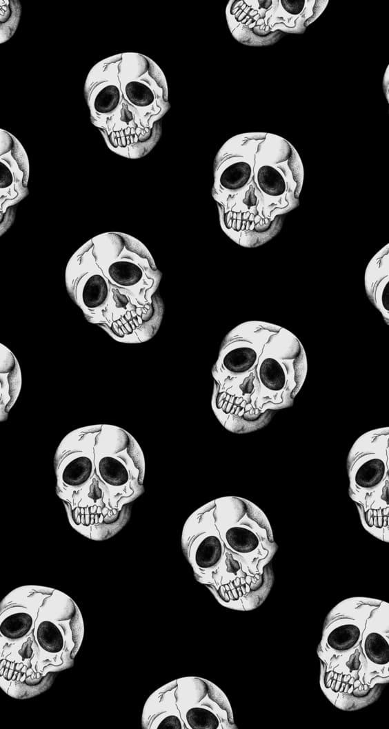 black wallpaper with white skulls